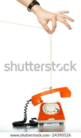 Someone pulling rope with orange phone. Isolated over white background - stock photo