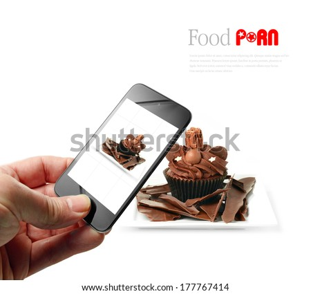 Someone taking a food selfie with a mobile device. A trend in restaurants causing controversy with chefs as images are posted on social networks by food lovers, known as food porn. Copy space. - stock photo