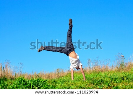 somersault on the summer meadow - stock photo