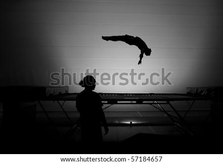 somersault trampoline silhouette - stock photo
