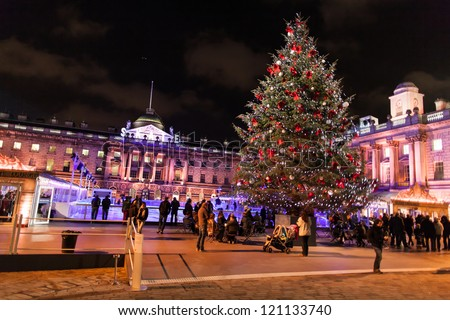 Somerset place (central London) pictured at night with Christmas tree and ice-skating rink - stock photo