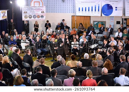 Somerville,New Jersey-MARCH 10,2015:New Jersey Governor Chris Christie welcomes town hall participants during his 130th Town Hall Meeting at Van Derveer School on March 10,2015 in Somerville,NJ. - stock photo
