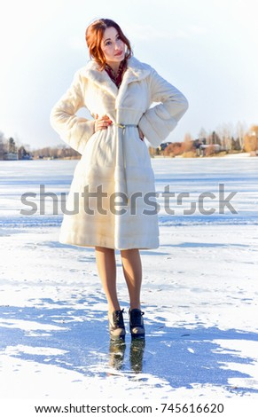Something about winter and Christmas, Winter is a magical time for dreams come true. Beautiful portrait of woman in the winter snowy scenery. Happy  magic moments of pretty young woman