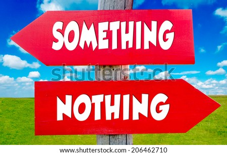 Something and nothing concept on the red signs with landscape in background - stock photo