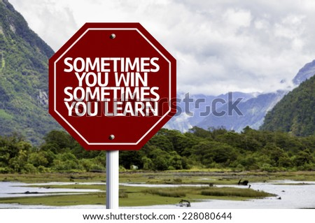 Sometimes you Win Sometimes you Learn red sign with a landscape background