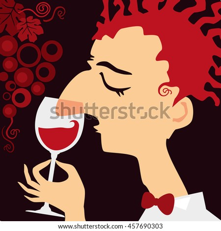 Sommelier - a wine steward. Wine tasting specialist smells a glass of red wine.