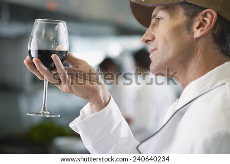 Sommelier Looking at Wine - stock photo