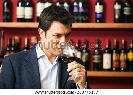 Sommelier tasting a glass of red wine
