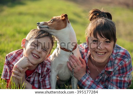 Son and mom with dog in park