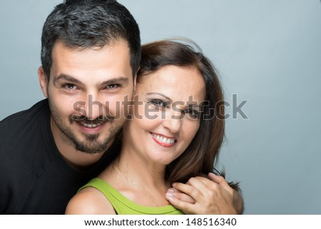 Son and mother smiling - stock photo