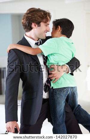 Son Greets Father On Return From Work - stock photo
