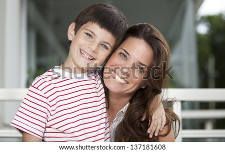 Son holding her mother - stock photo