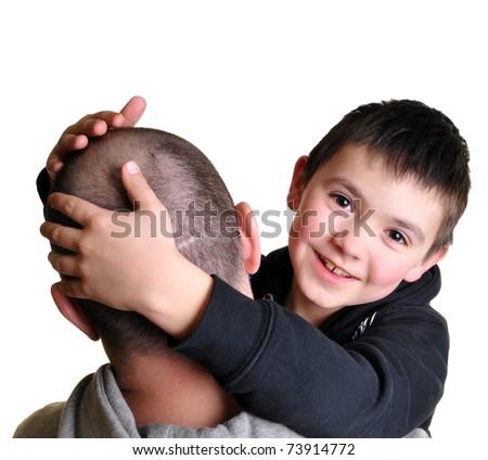 son hugging his dad - stock photo