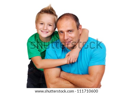 Son hugging his father - stock photo