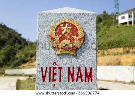 Son La, Vietnam - Jan 10, 2016: Close up of an aged emblem of Vietnam on a frontier milestone among Vietnam and Laos in a border bell area of Moc Chau highland, north west of Vietnam. - stock photo