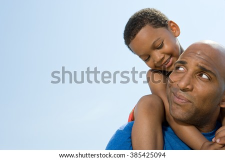 Son on fathers shoulders - stock photo