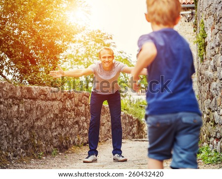 Son runs  to his father hugs