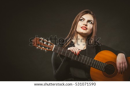 Song music handicap disability concept. Handicapped girl holding guitar. Crippled beautiful lady playing music enjoying her passion.