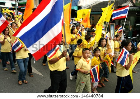 SONGKHLA - DEC 5: Royalists celebrate the 80th birthday of Thai King Bhumibol Adulyadej while attending celebrations on street on Dec 5, 2007 in Southern Songkhla, Thailand.  - stock photo