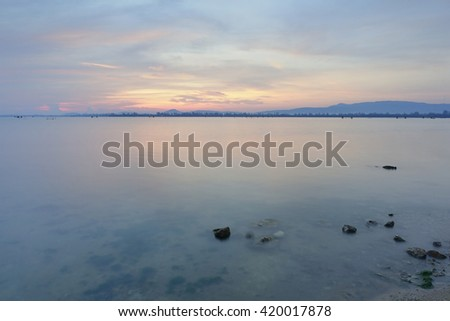 Songkhla Lake at Songkhla Thailand view in the morning time before Sunrise on Long exposure shot,select focus with shallow depth of field,Soft focus, noise and grain due long exposure.
