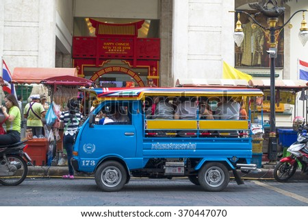 SONGKHLA, THAILAND -JANUARY 31, 2016: Passenger of blue mini truck taxi Hat Yai city, Service downtown Hat Yai city, Thailand