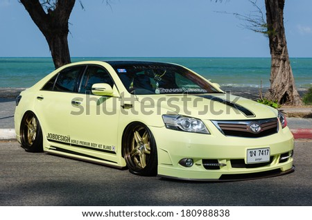 """SONGKHLA, THAILAND - March 09 : Tuned car Toyota camry in """"Songkhla Car Club Show 2014"""" at Samila beach on March 09,2014 in Songkhla, Thailand. - stock photo"""