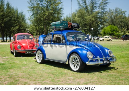 "SONGKHLA, THAILAND - May 01 : Vintage Volkswagen car Meeting in ""VW SONGKHLA AIRCOOLED GATHERING SEASON 3"" at Samila beach on May 01,2015 in Songkhla, Thailand."