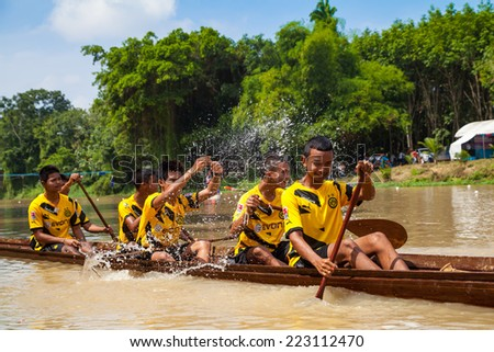 SONGKHLA, THAILAND-OCT 9: Unidentified rowers enjoy in Ku-Tao traditional boat factival on October 9, 2014 in Songkhla ,Thailand.,