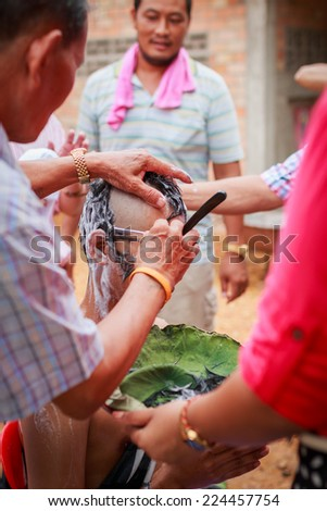 SONGKLA,THAILAND JULY 6 : Male who will be monk cut hair for be Ordained. Thailand on July 6, 2014