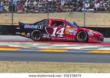 SONOMA, CA - JUN 24, 2012:  Tony Stewart (14) brings his car through the turns during the Toyota Save Mart 350 at the Raceway at Sonoma in Sonoma, CA on June 24, 2012.