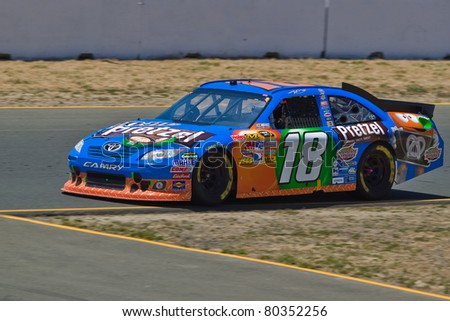 SONOMA, CA - JUNE 26: Kyle Busch (18) at speed during 2011 Toyota/Save Mart 350 Commercial, the NASCAR Sprint Cup Series race on June 26, 2011 at the Infineon Raceway in Sonoma, CA. - stock photo