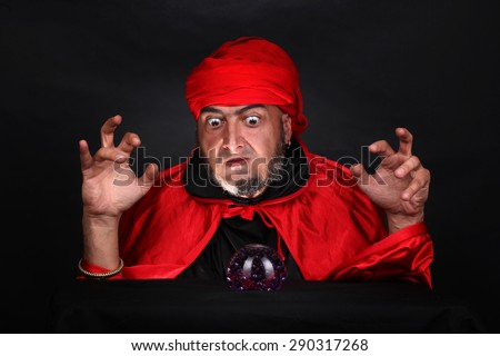 Soothsayer predicts future fortune telling using crystal ball - stock photo