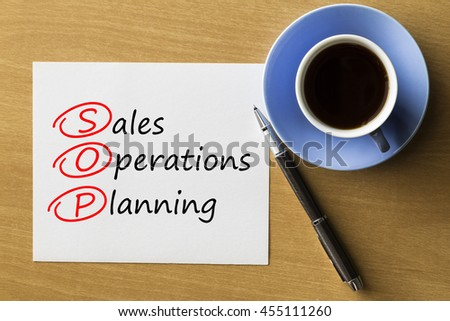 SOP Sales and Operations Planning - handwriting on paper with cup of coffee and pen, acronym business concept
