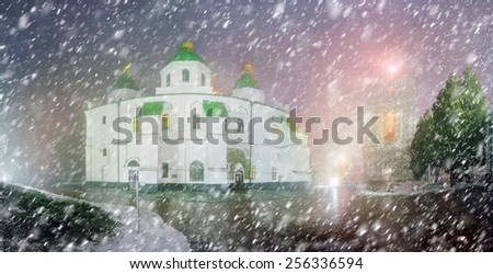 Sophia Winter evening night shot of the ancient temple of Kievan Rus during a snowfall fog, among the trees of the old monastery garden and park in front of illumination during Christmas and New Year - stock photo