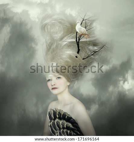 Sophisticated and artistic portrait of a beautiful female model with a white dove on a branch in the very long blond hair  - stock photo