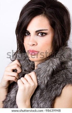sophisticated and beautiful Latin model with fur coat