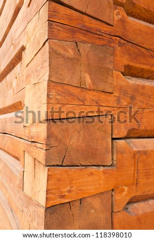 Sophisticated construction of joints of wooden timber logs meeting at the corner of log house - stock photo