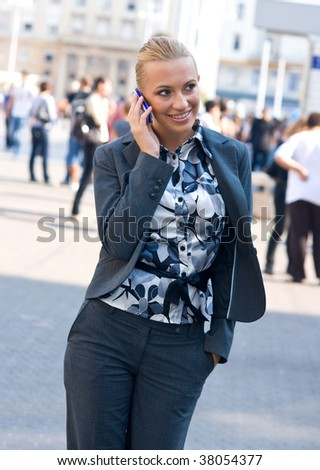 sophisticated woman talking to mobile phone in the street