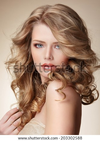 Sophisticated Woman with Perfect Skin and Flowing Blond Healthy Hair - stock photo