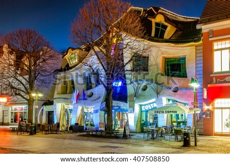 SOPOT, POLAND - APRIL 14, 2016: Crooked House at night on the Monte Cassino street with many shops, clubs, galleries. Sopot is a very popular tourist resort in the country.