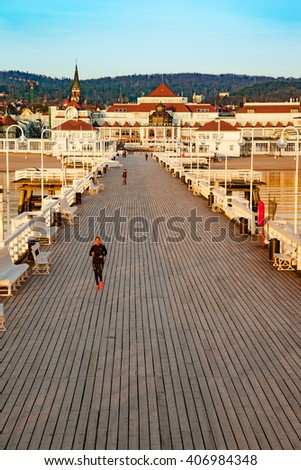 SOPOT, POLAND - APRIL 10, 2015: People walking on the Sopot Pier built in 1827. At 511m, the pier is the longest wooden pier in Europe. - stock photo