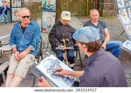 Sopot, Poland - August 1, 2015 in Sopot is one of the most popular tourist resorts in Poland. Street artists and cartoonists in the street of Monte Cassino in Sopot.