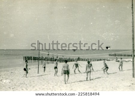 SOPOT, POLAND, CIRCA FIFTIES: Young people play volleyball on the beach, vintage photo - stock photo