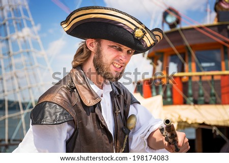 SOPOT, POLAND - 7 JUNE: Man posing in pirate outfit on Sopot molo, 7 June 2014. Sopot is major health and tourist resort destination and has the longest wooden pier in Europe.