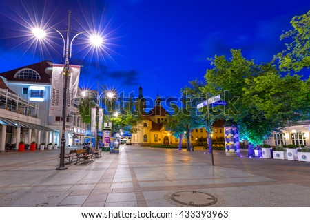SOPOT, POLAND - JUNE 6, 2016: Promenade to the pier (Molo) in Sopot city at night, Poland. Sopot is major health and tourist resort destination and has the longest wooden pier in Europe.