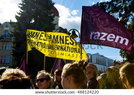 Sopot, Poland, 2016 09 24 - protest against anti-abortion law forced by Polish government; flags of Amnesty International and Razem Party