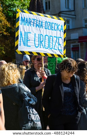 "Sopot, Poland, 2016 09 24 - protest against anti-abortion law forced by Polish government; people with banner saying: ""dead i can't give birth"""