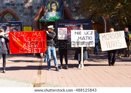 Sopot, Poland, 2016 09 24 - protest against anti-abortion law forced by Polish government; people with banners: government have blood of women on hands, people of PIS you'll go to hell for this law