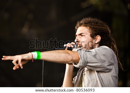 SOPRON, HUNGARY - JUL 2: Singer from the hungarian band Riddim Colony sing on the MR2 stage on the Volt Festival, on Jul 2, 2011 in Sopron, Hungary. - stock photo