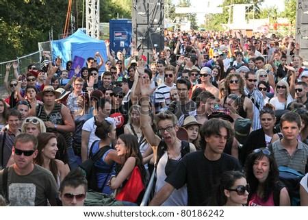 SOPRON, HUNGARY - JUN 28: Young people wait for the Door Open on the Volt Festival on Jun 27, 2011 in Sopron, Hungary. Volt is one of the most exciting multicultural festivals in Central Europe.